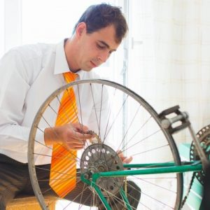 https://pixabay.com/en/man-male-bicycle-repair-tie-1148982/